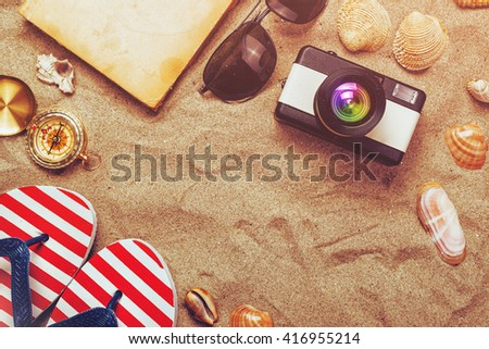 Summer holiday vacation accessories on beach sand, lifestyle objects in flat lay top view arrangement. - stock photo