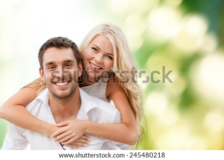 summer holiday, vacation, dating and love concept - happy couple having fun over green background - stock photo