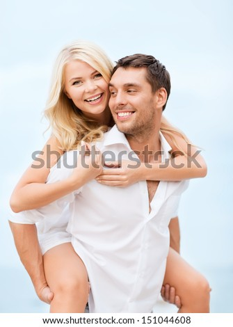 summer holiday, vacation, dating and tourism concept - happy couple having fun on the beach - stock photo
