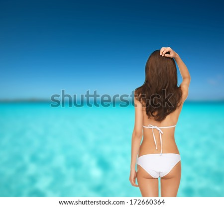 summer holidays and vacation concept - beautiful woman posing in white bikini - stock photo