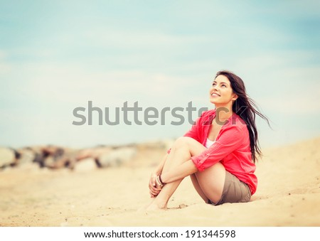 summer holidays and vacation - girl sitting on the beach - stock photo