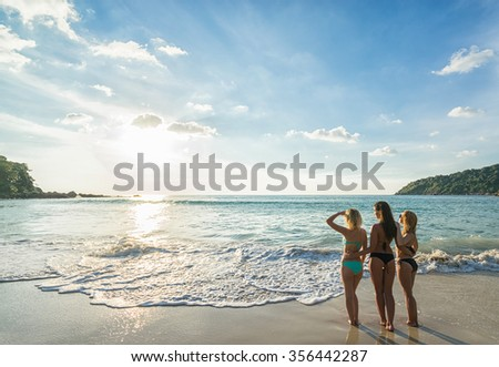Summer holidays and vacation - girls sunbathing on the beach. Tropical vacation .Thailand . Phuket . Freedom beach.