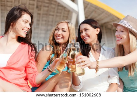 summer holidays and vacation - girls with drinks on the beach - stock photo