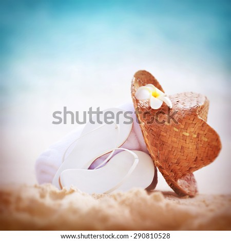 Summer holidays background, beautiful beach items on sandy coast, vacation border with copy space, traditional beachwear, relaxation concept  - stock photo
