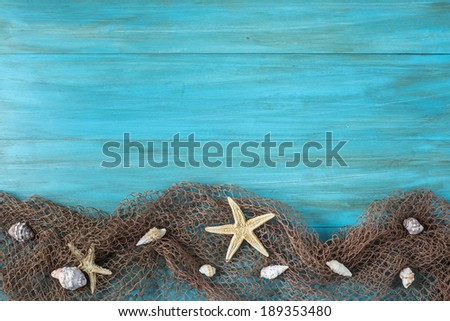 Summer holidays background in blue with fishing net ans seashells and a space for advertising - stock photo