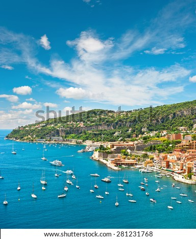 Summer holidays background with beautiful blue sky. French riviera, Mediterranean Sea. View of luxury resort and costline of Villefranche by Nice France - stock photo