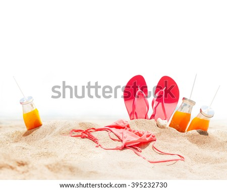 Summer Holidays Beach Seashore Accessories Sand Juice Bikini Slippers Isolated in White - stock photo