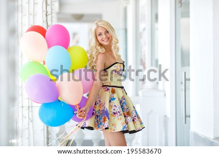 summer holidays, celebration and lifestyle concept - beautiful blonde woman with colorful balloons in the city. Bright summer portrait - stock photo