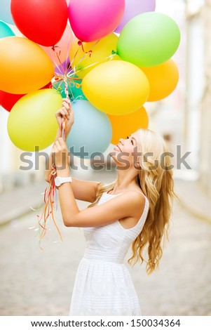 summer holidays, celebration and lifestyle concept - beautiful woman with colorful balloons in the city - stock photo