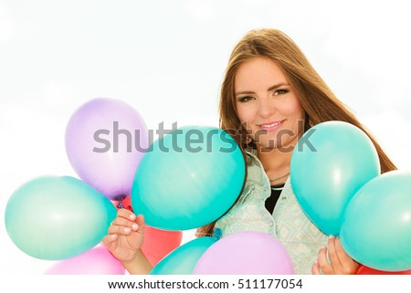 Summer holidays, celebration and lifestyle concept - Closeup beautiful woman face teen girl with colorful balloons outside