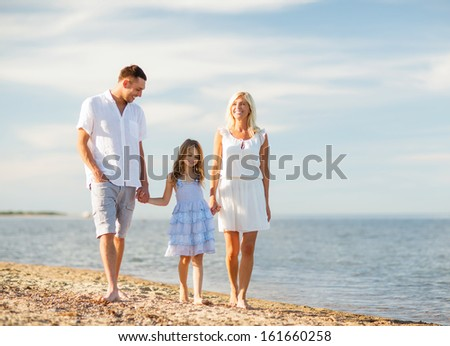 summer holidays, children and people concept - happy family at the seaside