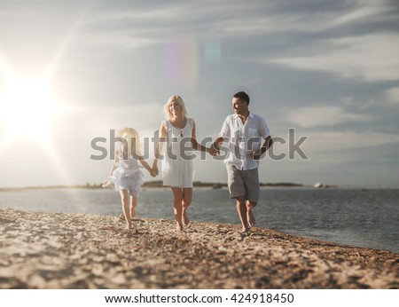 summer holidays, children and people concept - happy family at the seaside - stock photo