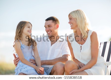 summer holidays, children and people concept - happy family having a picnic - stock photo