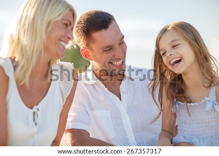 summer holidays, children and people concept - happy family having a picnic