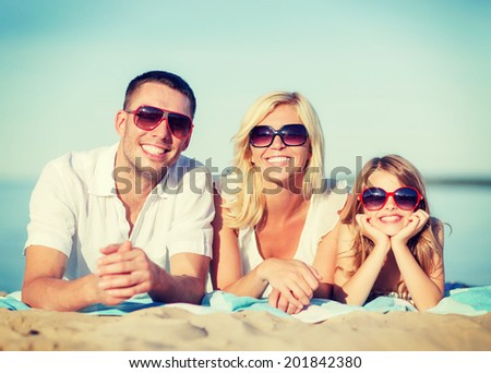 summer holidays, children and people concept - happy family on the beach - stock photo