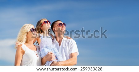 summer holidays, children and people concept - happy family with blue sky - stock photo