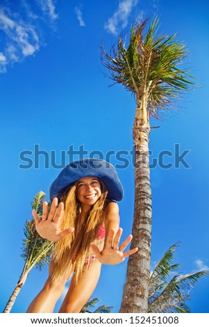 summer holidays concept - woman under the exotic palm tree - stock photo