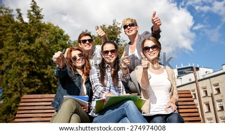 summer holidays, education, campus and teenage concept - group of students or teenagers showing thumbs up - stock photo