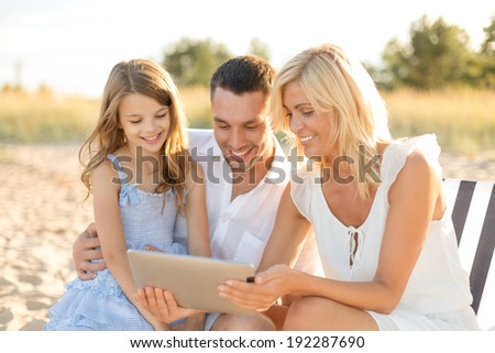 summer holidays, family, child and technology concept - smiling family at beach with tablet pc computer - stock photo