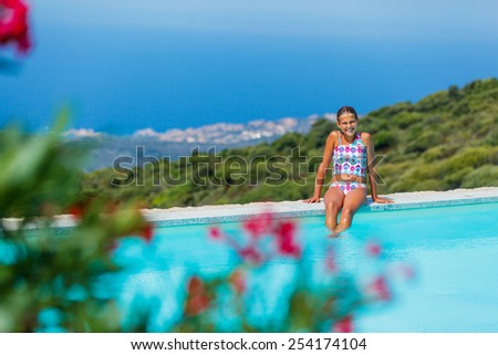 Summer holidays - Girl relaxation and  sunbathing near pool. - stock photo