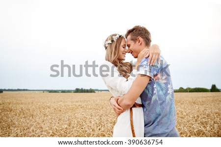 summer holidays, love, romance and people concept - happy smiling young hippie couple hugging outdoors - stock photo