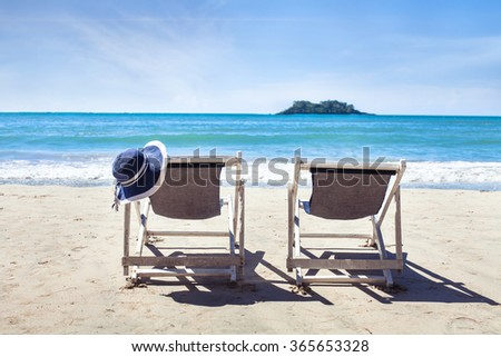 summer holidays on paradise beach, two deckchairs near the sea, family vacations - stock photo