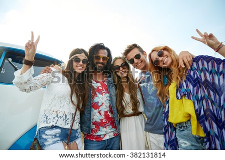 summer holidays, road trip, vacation, travel and people concept - smiling young hippie friends over minivan car showing peace hand sign - stock photo