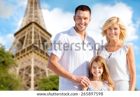 summer holidays, travel, tourism and people concept - happy family in paris over eiffel tower background - stock photo