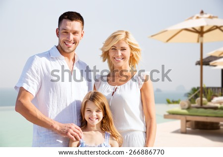 summer holidays, travel, tourism and people concept - happy family on vacation over resort beach background - stock photo