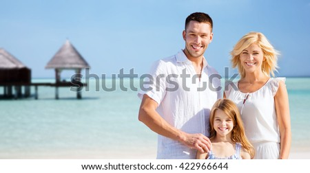 summer holidays, travel, tourism, vacation and people concept - happy family over exotic tropical beach with bungalow hut background - stock photo