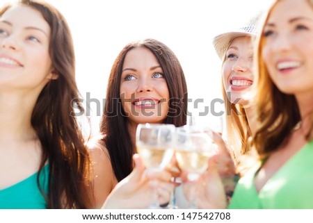 summer holidays, vacation and celebration - girls with champagne glasses - stock photo