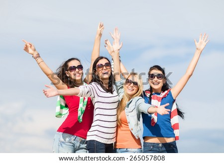 summer, holidays, vacation and people concept - beautiful teenage girls or young women having fun on beach - stock photo