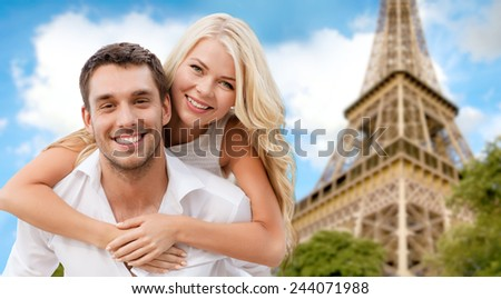 summer holidays, vacation, dating and travel concept - happy couple having fun over eiffel tower background - stock photo