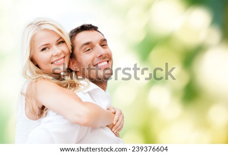 summer holidays, vacation, dating, love and people concept - happy couple having fun over poppy flowers field and blue sky background