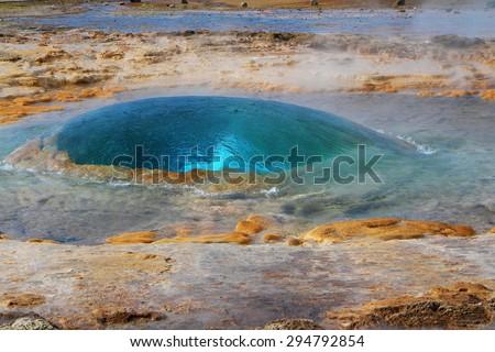Summer Iceland. Famous geyser Strokkur preparing to erupt - stock photo
