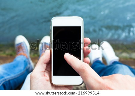Summer, internet, education concept - Couple using smart phone mobile outdoors - stock photo