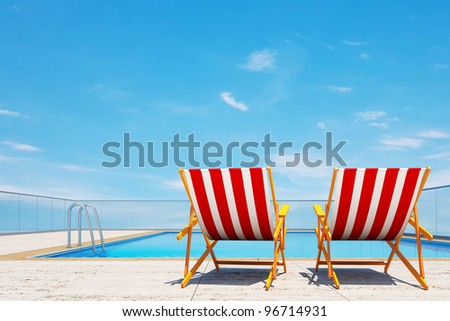 Summer is coming concept, 3d swimming pool with beach chairs
