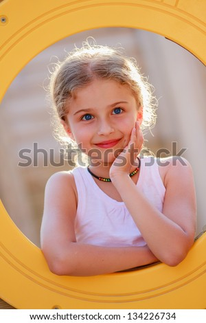 Summer joy - lovely girl on playground, happy child concept - stock photo