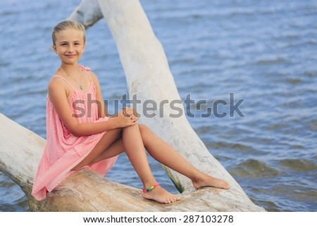 Summer joy - portrait of young, fashion girl on the beach - stock photo