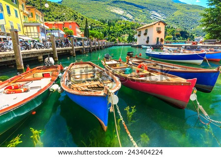 Summer landscape and wooden boats,Lake Garda,Torbole town,Italy,Europe - stock photo