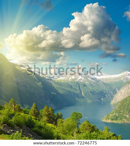 Summer landscape. Blue sky, mountains and fjord - stock photo