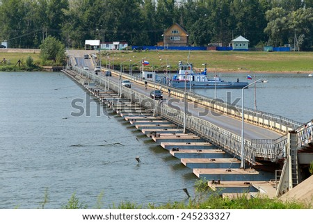 summer landscape bridge over the river White near the town of  Birsk on a clear day