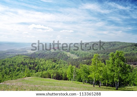 Summer landscape. Green hill and blue sky. - stock photo