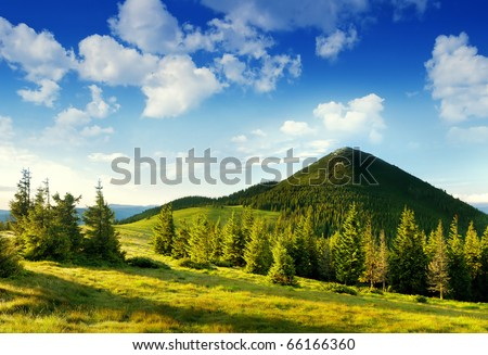 Summer landscape in mountains and the dark blue sky with clouds - stock photo