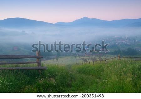 Summer landscape in the countryside. Morning fog. Carpathians, Ukraine, Europe - stock photo