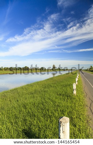 Summer landscape in the countryside with blue sky - stock photo