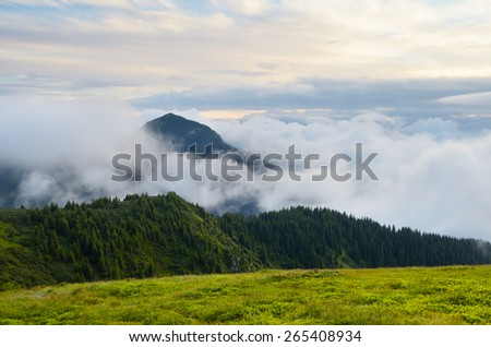 Summer landscape. Mountains in the clouds. Beauty in nature. Carpathians, Ukraine, Europe - stock photo