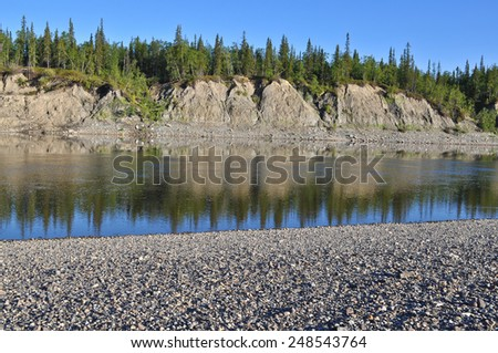 Summer landscape North of the river. Polar Ural, Komi Republic, the beaches along the banks of the river. - stock photo