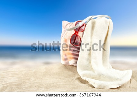 summer landscape of beach and blue sky with bag