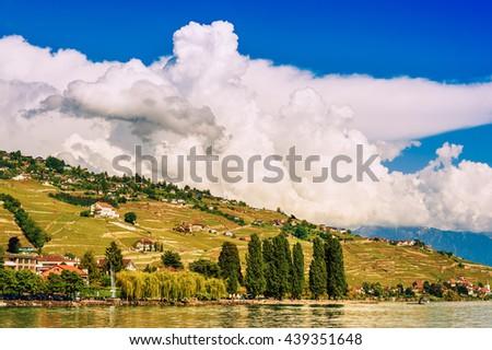 Summer landscape of Lake Geneva with amazing clouds, Lavaux vineyards and Alps, Switzerland - stock photo